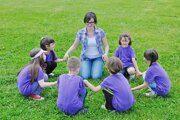 depositphotos_11730939-stock-photo-happy-kids-group-with-teacher